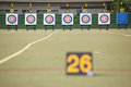 Archery targets at various distances on a range focus only on the closest target Stock Images