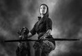 Archery woman beautiful and dog sky on background black and white image Stock Photography