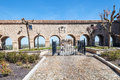 Arches of colegiata de san pedro in lerma burgos in the north spain you can see the courtyard with path and garden in the wall Royalty Free Stock Photo