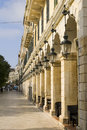 Arches and lanterns in line, Corfu, Greece Royalty Free Stock Photo
