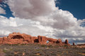 Arches national park landscape photograph of an early autumn stunning cloudscape amidst the beauty of one of parks more popular Stock Photography