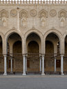 Arches surrounding the courtyard of a historic mosque, Egypt Royalty Free Stock Photo