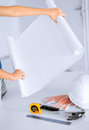Architect with blank blueprint architecture and home renovation concept flexible ruller and helmet Royalty Free Stock Image
