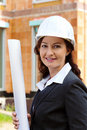 Architect with blueprint on construction site Royalty Free Stock Photography