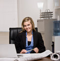 Architect with blueprints at desk Stock Photos