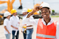Architect at a building site happy male wearing helmet Stock Image