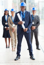Architect colleagues happy african american standing in front of in modern office Stock Photo