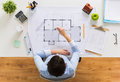Architect with compass measuring blueprint Royalty Free Stock Photo