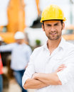 Architect at a construction site male with arms crossed working Royalty Free Stock Image