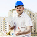 Architect on construction site portrait of smiling at Stock Photo