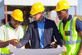 Architect construction workers group of male and on site Stock Photography