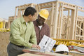 Architect And Foreman At Construction Site Royalty Free Stock Photography