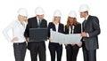 Architect group analyzing blueprints with laptop on white background Stock Photos