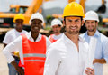 Architect with a group of construction workers holding blueprints Stock Image