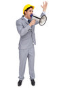 Architect with hard hat shouting with a megaphone on white background Stock Images
