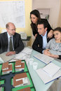 Architect having meeting with young family Royalty Free Stock Images