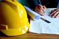 architect man working with blueprints,engineer inspection in wor Royalty Free Stock Photo
