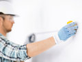 Architect measuring wall with flexible ruler architecture and home renovation concept male Royalty Free Stock Image