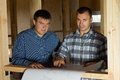 Architect Men with Blueprint Looking at Camera Royalty Free Stock Photo