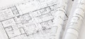 Architect rolls and plans architectural plan technical project drawing Royalty Free Stock Images