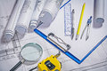 Architect tools blueprints cipboard magnifer ruller Royalty Free Stock Photo