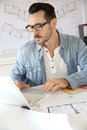 Architect using laptop in office portrait of working on project Stock Images