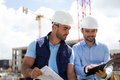Architect and worker planning meeting on construction site Royalty Free Stock Photo