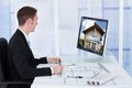 Architect Working On Blueprint While Looking At Co Royalty Free Stock Photo