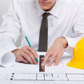 Architect working with a floorplan Royalty Free Stock Images