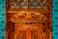 Architectonic detail the of a historical carved wooden door Stock Images