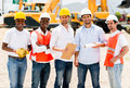 Architects at a building site group of looking happy Stock Images