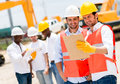 Architects at a construction site team of working Royalty Free Stock Image