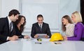 Architects discussing business plans in office Stock Photo