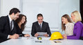 Architects discussing business plans in office Royalty Free Stock Photography