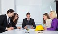 Architects discussing business plans in office Royalty Free Stock Photo