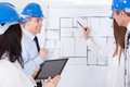 Architects discussing project group of new on whiteboard Royalty Free Stock Photo