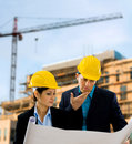 Architects reading blueprint Stock Photo