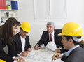 Architects sitting at table and looking at a project Royalty Free Stock Photo