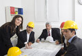 Architects sitting at table and looking a project Stock Image
