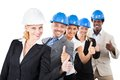 Architects wearing hardhats while gesturing thumbsup portrait of multiethnic against white background Stock Photos