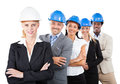 Architects wearing hardhats while standing arms crossed portrait of multiethnic against white background Royalty Free Stock Images