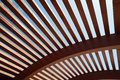 Architectural construction of wooden slats modern with half round openwork design Royalty Free Stock Images