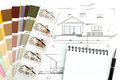 Architectural drawing with notepad blueprint of and color samples Royalty Free Stock Photos