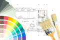 Architectural drawing with palette paintbrushes and colorful paint samples on house plan blueprint background Stock Photo