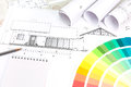 Architectural planning architect s and designer s work space during work with technical drawing and color samples catalog Royalty Free Stock Images