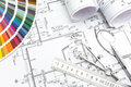 Architectural planning of interiors architect s and designer s work space during work with technical drawing and color samples Stock Photography