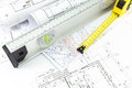 Architectural plans and measurement tools house building construction with spirit level tape measure Royalty Free Stock Photography
