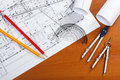 Architectural plans pencils and ruler on the desk Royalty Free Stock Photos
