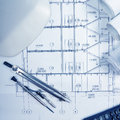 Architectural project, blueprints, blueprint rolls, compass divider, calculator, white safety on plans. Engineering tools view fro Royalty Free Stock Photo