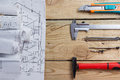 Architectural project, blueprints, blueprint rolls and divider compass, calipers on vintage wooden background. Construction concep Royalty Free Stock Photo
